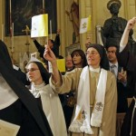 Nuns wave Vatican flags before Pope Benedict XVI's visit to Jerusalem. Click to enlarge