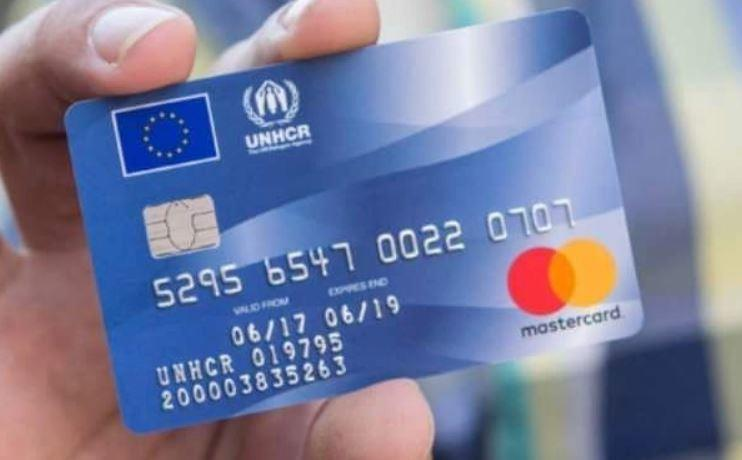 Migrant Mastercard. Click to enlarge