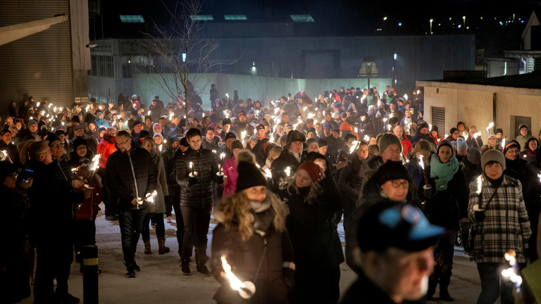 People from Maren Ueland's hometown walk in a torch-lit march to honor Maren Ueland from Norway and Louisa Vesterager Jespersen from Denmark. Clickm to enlarge