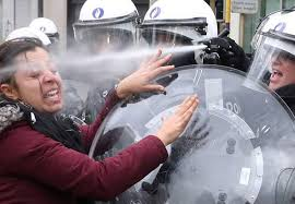 Protester gets a full blast of tear gas in her face