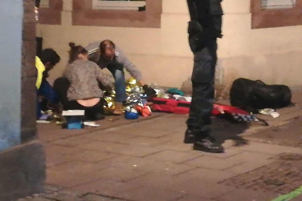 Picture taken with a mobile phone shows rescuers treating an injured person in the streets of Strasbourg. Clcik to enlarge