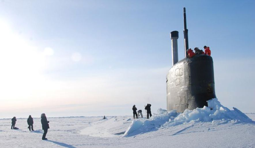 US Navy submarine breaks through the ice in the Beaufort Sea off the coast of North Alaska. Click to enlarge