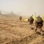 Marines with Bravo Company, 1st Battalion, 7th Marine Regiment, sprint across a field to load onto a CH-53E Super Stallion helicopter during a mission in Helmand province, Afghanistan, July 4, 2014. (U.S. Marine Corps photo by Cpl. Joseph Scanlan / released)