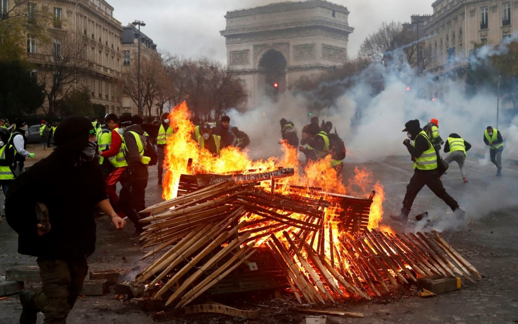 """Demonstrators during a protest of """"yellow vests"""" against rising oil prices and living costs, near the Champs Elysees in Paris, France, on December 1, 2018. Click to enlarge"""