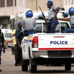 Police patrol the streets of Harare. Click to enlarge