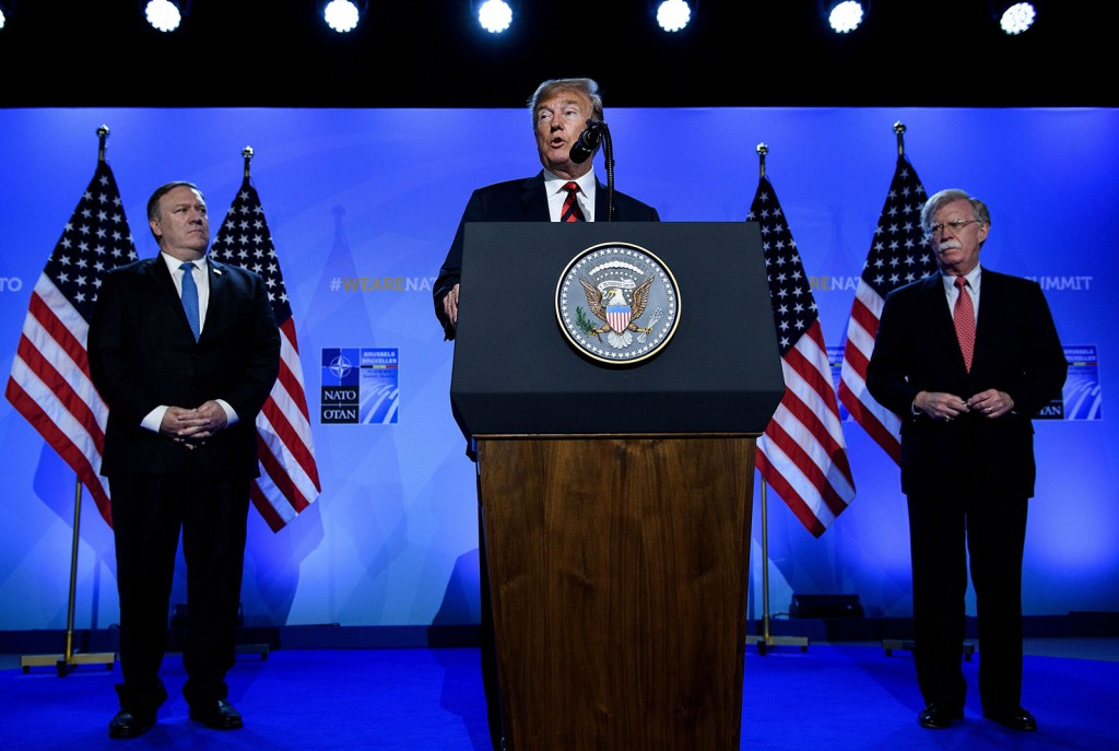 US President Donald Trump (C) is accompanied by US Secretary of State Mike Pompeo (L) and US National Security Advisor John Bolton (R) as he addresses a press conference on the second day of the North Atlantic Treaty Organization (NATO) summit in Brussels on July 12, 2018. (Photo by Brendan Smialowski / AFP)        (Photo credit should read BRENDAN SMIALOWSKI/AFP/Getty Images)