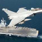 Dassault Rafale flies over Charles de Gaulle aircraft carrier. Click to enlarge