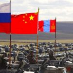 Russian, Chinese and Mongolian national flags are displayed on armored vehicle. Click to enlarge