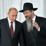 Putin is false opposition, claims Andy. His deferential body language with Russia Chief Rabbi Berel Lazar speaks volumes.