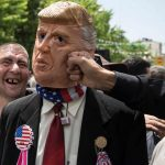 Demonstrators punch a man in a Donald Trump mask at an anti-US rally in Tehran. Click to enlarge