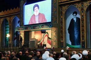 Supporters of Lebanon's Shia movement Hezbollah listen to recent speech by leader Hassan Nasrallah on large screen. Click to enlarge