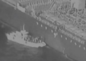 Still from a video released by the US Central Command allegedly shows Iranian Revolutionary Guards removing an unexploded limpet mine from tanker. Of course this blurred image proves exactly nothing and could easily have manipulated. Click to enlarge