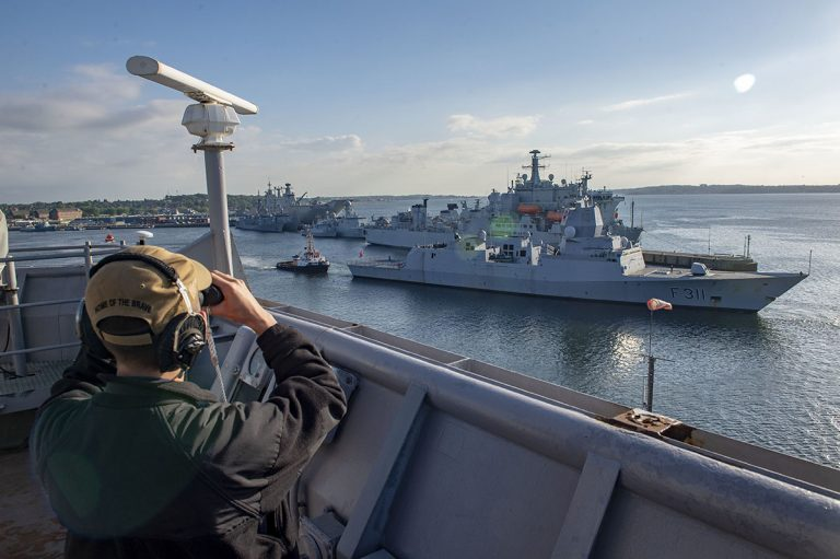 190609-N-AT530-1031 KIEL, GERMANY (June 9, 2019) Personnel Specialist 3rd Class Vadim Strelnikov observes as the Norwegian Fridtjof Nansen-class frigate HNoMS Roald Amundsen (F 311) departs Kiel, Germany for Baltic Operations (BALTOPS) 2019, June 9. BALTOPS is the premier annual maritime-focused exercise in the Baltic Region, designed to enhance flexibility and interoperability among the 18 participating allied and partner nations. (U.S. Navy photo by Mass Communication Specialist 2nd Class Chris Roys/Released)