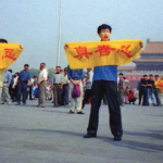 """Falun Gong practitioner is about to get arrested for holding banner that says """"Truth Compassion Tolerance"""" in Tiananmen Square, Beijing."""