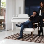 Gilbert Chikli, 50, and his wife Shirly Chikli, 31, pose for a photo at their villa in Ashdod, Israel, March 28, 2016. Click to enlarge
