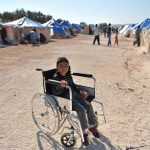 A Syrian boy on a wheelchair in Qah refugee camp. A UN report notes child casualty rates in Syria are the highest recorded. Click to enlarge