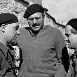 John Dos Pasos, left, and Hemmingway, centre, in Spain. Click to enlarge