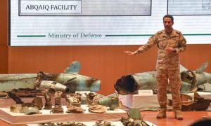 Lt Col Turki al-Maliki displays pieces of what he says were Iranian drones and missiles recovered from the attack sites. Click to enlarge