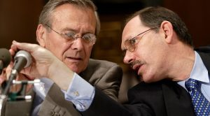 WASHINGTON, :  US Secretary of Defense Donald Rumsfeld (L) listens to Dr. Dov Zakheim (R), comptroller for the Department of Defense, as he testifies before the Senate Committee on Appropriations 07 May 2002 on Capitol Hill. Click to enlarge