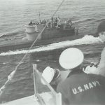 U234 surrendering to USS Sutton May 14, 1945, for escort to Portsmouth NH.Transport sub carried enriched uranium and other advanced Nazi technology. Click to enlarge