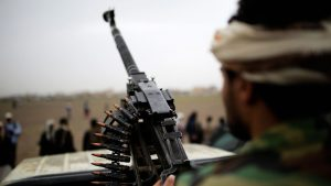A Houthi rebel fighter holds a weapon during a gathering aimed at mobilizing more fighters for the Houthi movement, in Sanaa, Yemen, Thursday, Aug. 1, 2019. The conflict in Yemen began with the 2014 takeover of Sanaa by the Houthis, who drove out the internationally recognized government. Months later, in March 2015, a Saudi-led coalition launched its air campaign to prevent the rebels from overrunning the country's south. (AP Photo/Hani Mohammed)