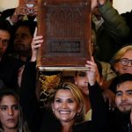 """The new president of the Plurinational State of Bolivia brandishes the """"Four Gospels"""" and denounces the """"satanic rites"""" of the Indians. Contrary to comments in the international press, she doesn't attack the Indians as an ethnic group, all of whom are Christians, but imposes religious fanaticism."""