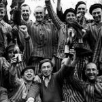 Happy concentration camp inmates celebrate their liberation. Click to enlarge