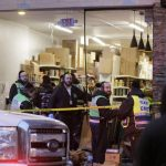 The scene in the aftermath of a gunbattle that ensued after Black gunmen open fire a a New Jersey kosher store. Click to enlarge