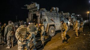 Turkish Army's commandos with armored personnel carriers in Reyhanli district of Hatay, Turkey, February 13, 2020. Click to enlarge