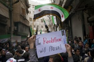 Anti-government protesters in Aleppo's Bustan al-Qasr neighbourhood in 2013. British objectives in Syria included 'promotion of the moderate values of the revolution' (AFP)
