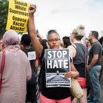 MINNEAPOLIS, MN - AUGUST 14:  A woman raises her fist at the front of a march down Washington Avenue to protest racism and the violence over the weekend in Charlottesville, Virginia on August 14, 2017 in Minneapolis, Minnesota. Protesters estimated at more than 1,000 blocked streets and light rail during the action.  (Photo by Stephen Maturen/Getty Images)