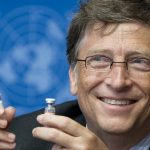 Bill Gates, Co-Chair the Bill and Melinda Gates Foundation shows a vaccine during the press conference. Click to enlarge
