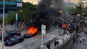 A police car burns as protesters gather near CNN offices in Atlanta, Georgia. Click to enlarge