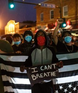 "Protestors with a sign saying""I can't breathe"" … while wearing masks that affect their breathing. Symbolic."