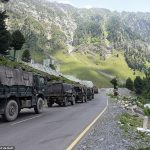 Indian Army convoy moves along the national Highway leading to Ladakh. Click to enlarge