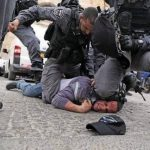 Israeli police detain a Palestinian protestor on March 12 2019. Click to enlarge
