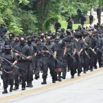 Armed Black militants on the march. Click to enlarge