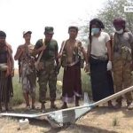 Yemeni forces with downed US made drone. Click to enlarge