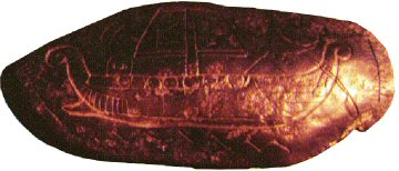 An engraved stone from Burrows Cave. Note the Roman style battering ram at the ship's prow.
