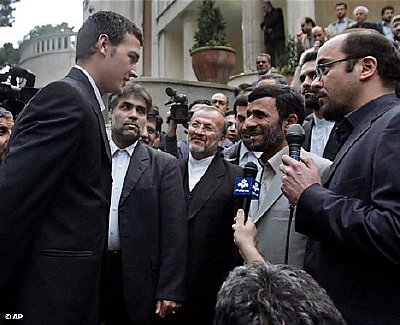 President Ahmadinejad meets with the Britons before a throng of reporters.