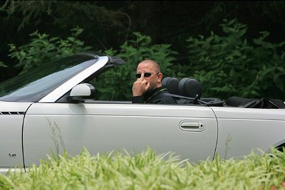 Many were seen driving in and out of the venue like this guy and his was a typical response. Maybe he is former Special Ops currently acting as an escort for one of the Bilderberg attendees. Or was he was an attendee or Federal agent? Either way your tax dollars are paying him.