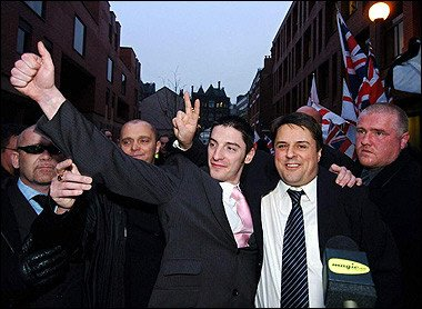 British National Party chairman Nick Griffin (2nd R) and co-accused BNP activist Mark Collett (L) celebrate with party supporters outside Leeds Crown Court in Leeds. Probably completely unaware of what they are helping to bring about.