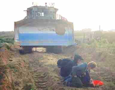Rachel Corrie lies dying after being crushed beneath the bulldozer's tracks