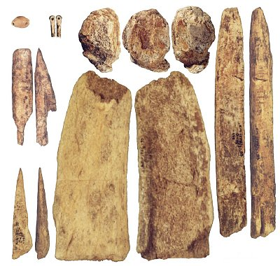Carved bone and ivory tools, excavated in Russia, made by early humans more than 40,000 years ago (Courtesy of A.A. Sinitsyn)