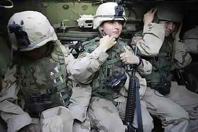 Female soldiers from the US 1st Cavalry Division check equipment before joining a patrol in Baghdad. Photo: AFP