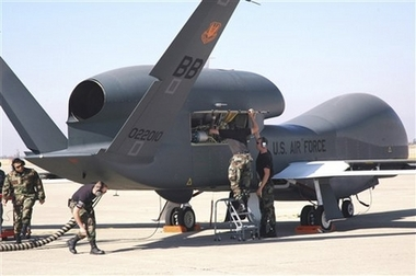 This undated image provided by the US Air Force shows avionics specialists preparing a Global Hawk for a runway taxi test at Beale Air Force Base, Calif.<br />