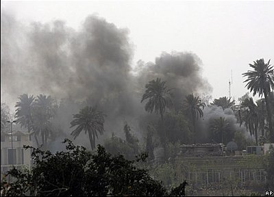 Wreathed in smoke from rocket and mortar strikes, the Green Zone Friday March 28, 2008.