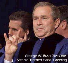 President Bush throws a familiar hand signal to those who in the know