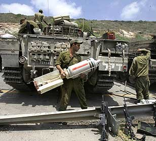 Israel using chemical delivery weapons in Lebanon. Fuse and chemical canister can be clearly seen in photo of Israel Defense Force personnel in Lebanon.