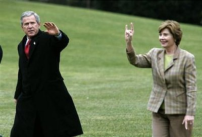 Laura Bush throws same salute.